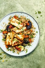 Roasted root vegetable salad with halloumi
